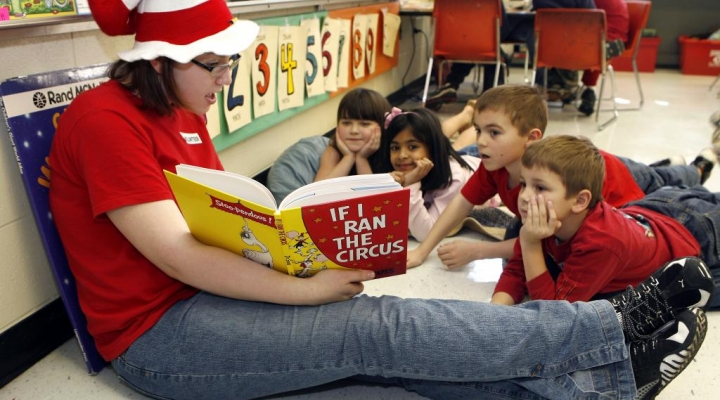 student reading to children